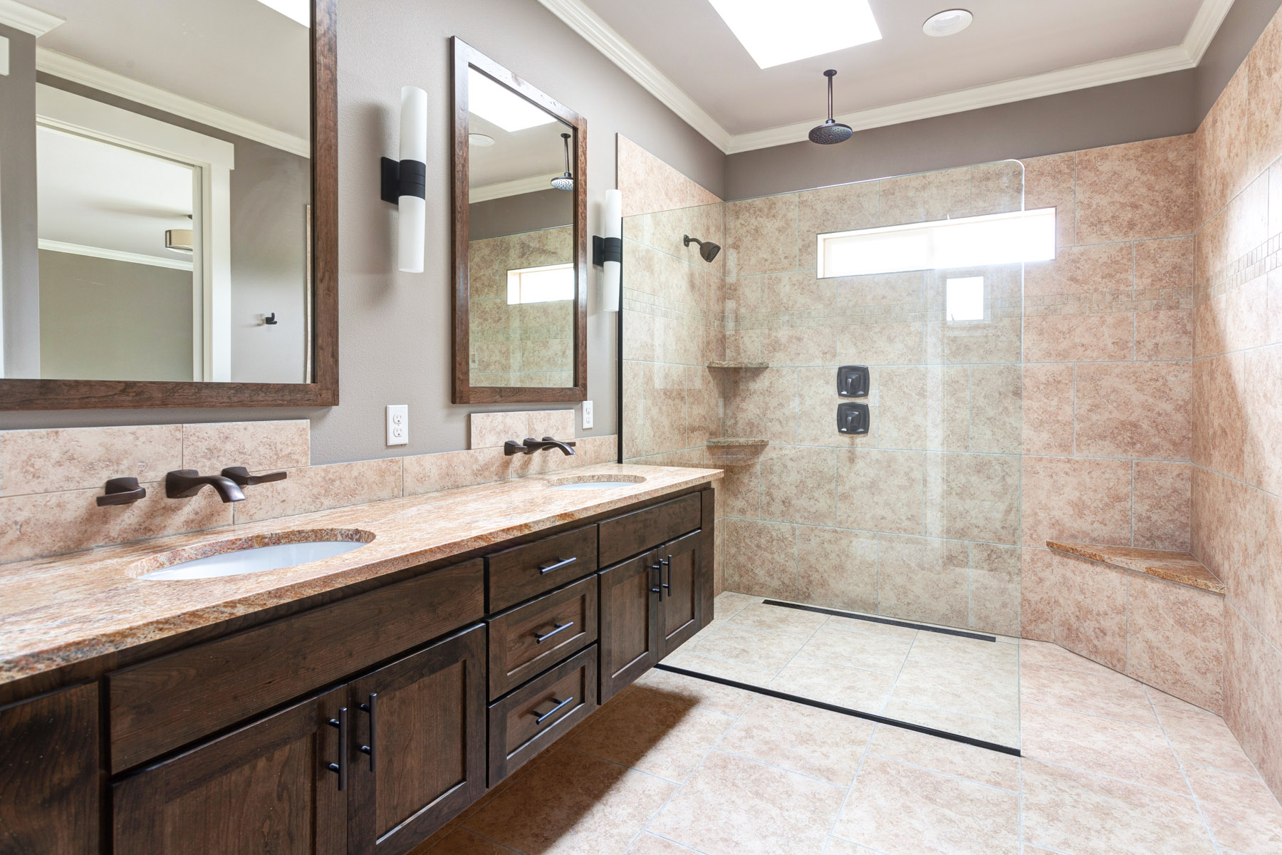 Full custom bathroom with heated floor and rain shower