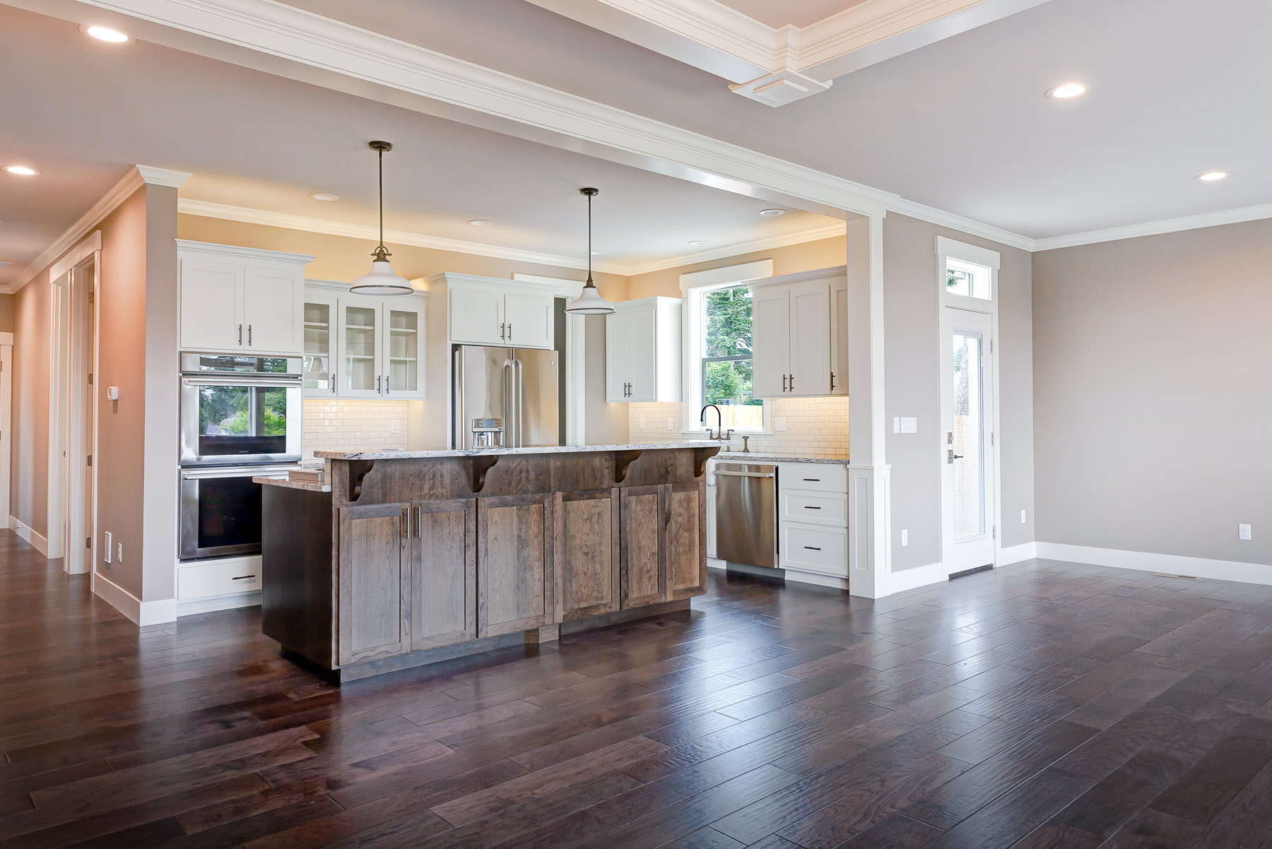 Very upscale kitchen with an island and crown moulding detail